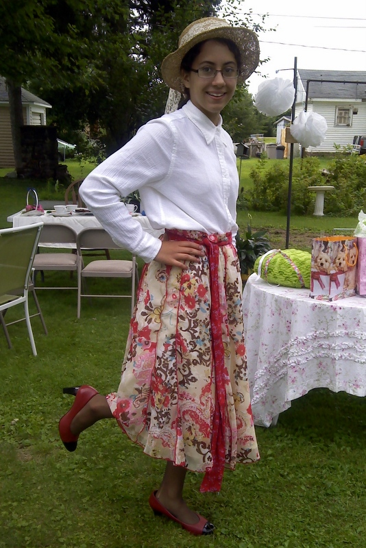 Elizabeth models her costume