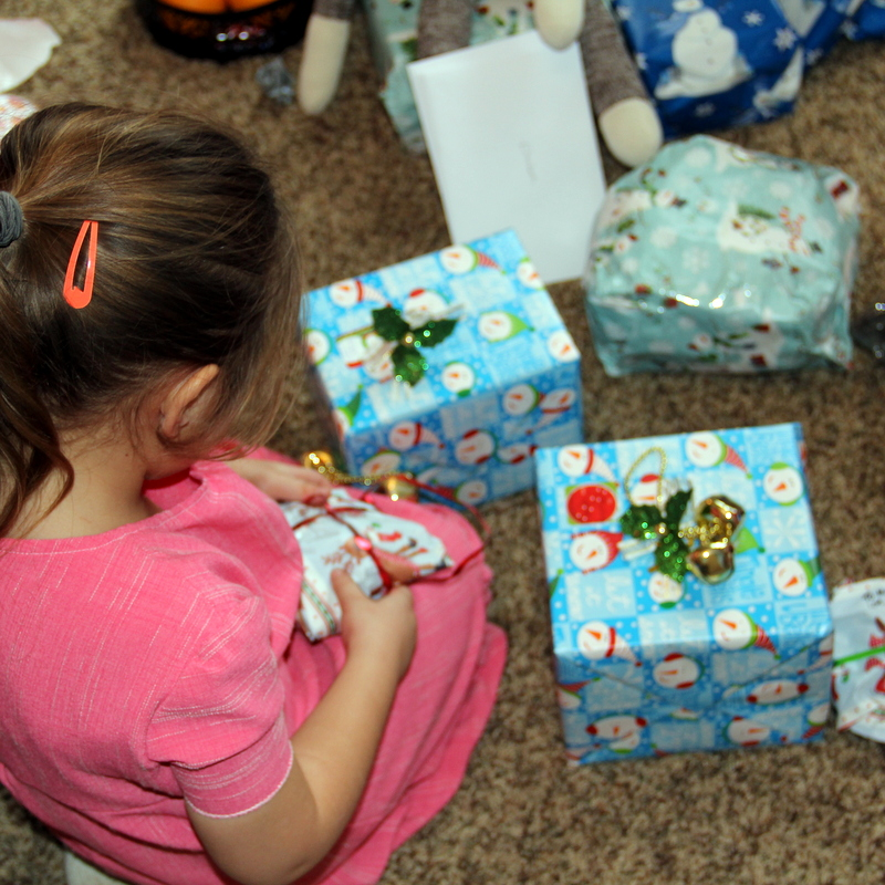 Madison opening presents at the Millers